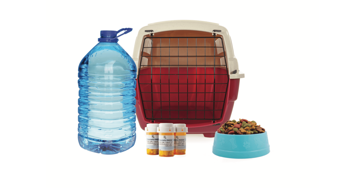 Image of pet emergency kit items including water, medication, food, and crate